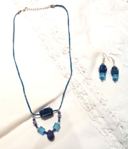 New blue felt necklace and earring set.